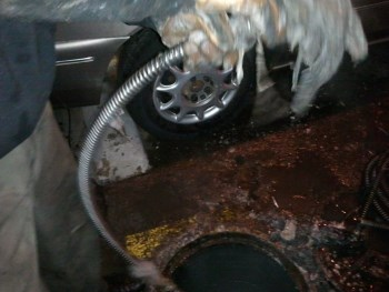 Rodding main sewer which was filled with baby wipes and grease